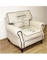 кресло в тканевой обивке с принтом